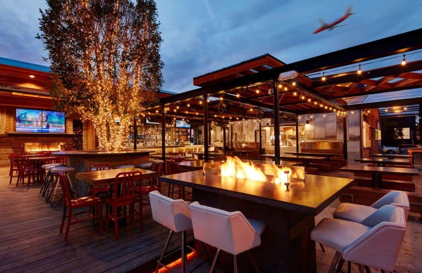 Picture of outdoor patio with string lighting and fire pit